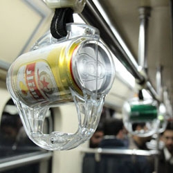 Funky advertisement: non-alcoholic beer cans as subway handles in Tehran/Iran. ONIZOU suggestion: for emergency situations and hot days, add an opening in the plastic cover so the beverage can be consumed.