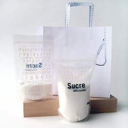 Sybile Adrien warning campaign about the danger of over consumption of sugar. Sugar associated diseases were printed in white on the bag making them legible only as the sugar level would lower.