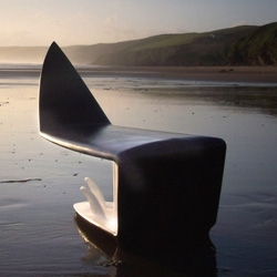 Designed by Adam Scott, this beautiful surfboard chair will look great in any office or home.