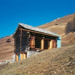 Devanthéry and Lamunière Architectes converted a classic alpine barn-stable into a summer cabin. Located in Val d'Hérens, Evolène, Switzerland, and you just know that view is  stunning...