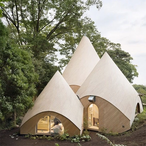 Jikka, a Japanese home complex developed by Tokyo-based architect Issei Suma. Stunning wooden teepee like structures.