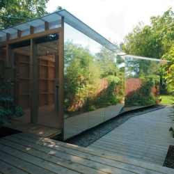 The summerhouse is a seasonal hideaway for a Hackney-based family of four, designed by Ullmayer Sylvester Architects. Simple structure but the mirror siding makes the whole thing much more interesting, and helps to enlarge the garden.