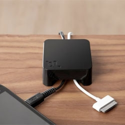 Sumo from Bluelounge acts like a paperweight for your cables, preventing them from dropping over the edge of the table.