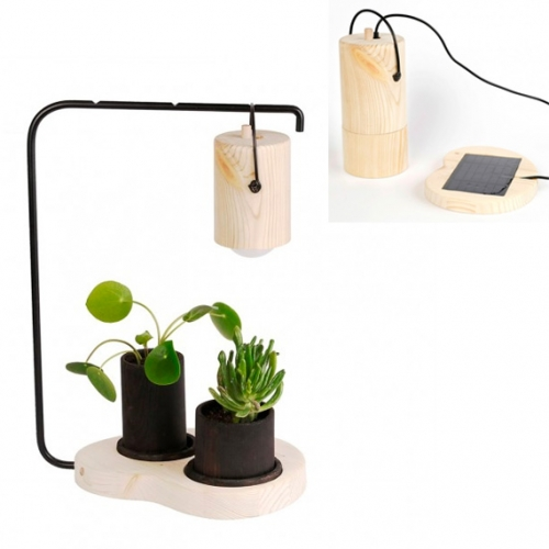 Lampa Fotosyntes by Sofia Ljung & Elia Anis. Such a lovely concept where the solar grow light can be moved to shift the growth of the plants!