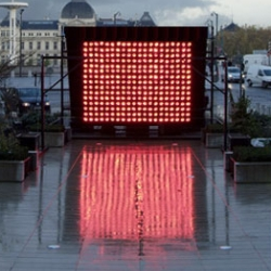 """Designed by Fabric, """"Perpetual Sunshine"""" uses a wall of glowing infared bulbs to imitate the exact temperatures and intensity of light from  tropical locations around the world."""