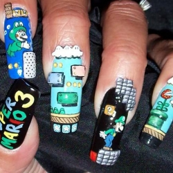 Super Mario Nails! Why go all traditional with those cuticles when you can dress them up as tiny cartoon characters from another dimension?
