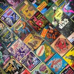 """A big fat giant collection of Super 8MM film reel boxes under the category """"lowbrow"""" - aka mayhem, madness, and monsters galore."""