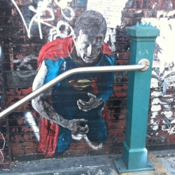 We're not sure who the artist is behind this amazing Superman wheatpaste outside of the Lorimer stop in Williamsburg, but we'd definitely agree that the oft-delayed L train could use some superhuman help most mornings.