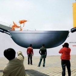 How does one build awareness for a premium range of non-stick pans? Develop a spectacular event using a giant wok and in-line skaters dressed as prawns, pork, eggs...  For Sapor, by Leo Burnett, Shanghai.