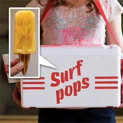 Surf Pop Popsicles with wooden surfboard sticks! ... with flavors that reflect sun, sand and sea. Sun= habanero peppers, lime, mango. Sand = almond, black sesame, caramel. Sea = cucumber, vanilla, mint.