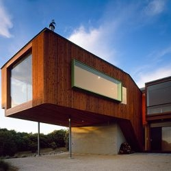 John Wardle Architects' Surf Coast House, sitting above the dunes at Anglesea in Victoria, AU, is a reinterpretation of the 'rude' beach shacks of days gone by.