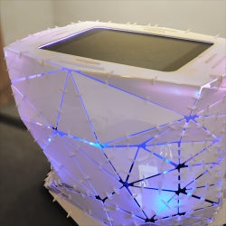 Microsoft Surface housed in Folded Acrylic Shell holding an interactive 11,000 artwork collection at Ball State University's Museum of Art.