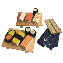 Dwell Studio's Magnetic Wooden Sushi Set - slices of magnetic wood fish, nori fabric, wasabi, bamboo mat, 2 serving boards and a travel bag to keep it all organized.