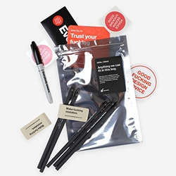"""Good Fucking Design Advice Swag Bag - """"Stickers, pencils, tattoos and more. A unique collection of GFDA tools for fun and productivity."""" Perfect for the designer who has everything."""