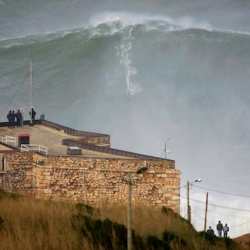 Big Wave Surfing in Nazare, Portugal - surfer Garrett McNamara rides world record 100ft wave in Portugal.