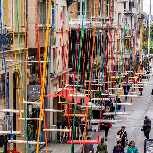 "Max Mertens ""Swings"" - an installation with 450 swings hanging above the Rue Philippe II and the Avenue de la Porte-Neuve in Luxembourg. Installation runs until August 2016."