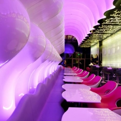 Karim Rashid has completed the interior of his first restaurant in Dubai, UAE. Called Switch, the restaurant is arranged along undulating walls that change color continuously.