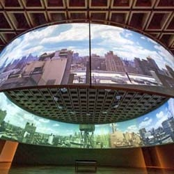 """T. J. Wilcox's 360-degree panoramic installation """"Up In the Air"""" at the Whitney Museum, takes a day in downtown NYC from dawn to dusk & plays it in an immersive 30-minute loop."""