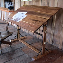 Walnut Drafting Table and Lofty Side Table, solid walnut and steel. Model T-Ford jack for lifting and lowering the table height, and Vintage Crane knobs allow for angle adjustment. By 2point54.