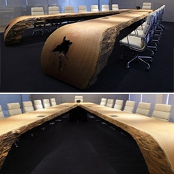 Incredible wooden conference table by Tora Brasil for Moema Wertheimer Arquitetura.