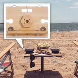 The SandStand is a handsomely woodworked table designed to keep bottles, glasses and cans up out of the sand.  It has beveled beverage holders, quality metal footman loops for hanging sunglasses, and built-in bottle openers. Super portable. American Made.