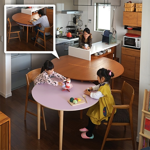 Yuki Miyamoto's table expands by rotating! Lovely design for this small family kitchen.