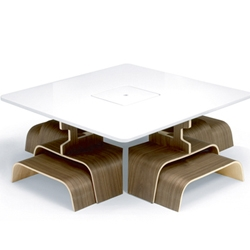 The Four-to-One table by Leon Fitzpatrick is a dining table with matching chairs. It draws inspiration from both Asian design (its low seating position) and mid-century Scandinavian design (use of bent plywood).