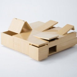 The Kai Table by Naoki Hirakoso and Takmitsu Kitahara appears to be a smooth wooden tabletop but unfolds to reveal numerous hidden storage compartments.