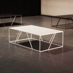 Julien Vidame designed this coffee table on architectural principles, proportions then lines, and the lightweight trapezoidal structure comes in stainless steel as well as different colors.