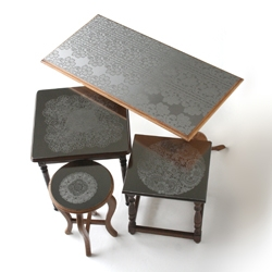 """Traditional lace in stainless steel"" - The used surface of second hand side tables gets a new lease of life by adding a decorative layer of etched stainless steel."