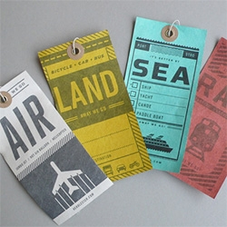 Herb Lester Luggage tags: air, rail, land, sea - Able to withstand rips, tears and rain! Printed on tyvek. Designed by us by Two Arms Inc of Brooklyn, NY.