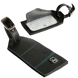 Alchemy Goods Luggage Tag made of  reclaimed truck tubes.