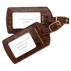Lovely leather luggage tags from Smythson ~ favorite detail is that they come marked Home and Destination ~ perfect for swapping so in case they get lost they find their way to the right location!