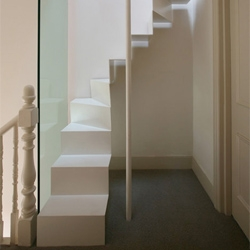 Clever and elegant stairs provide loft access in this London house by Tamir Addadi Architectures.