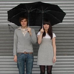 Tandem Umbrella.  An umbrella built for the inseparable. By Marc Owens