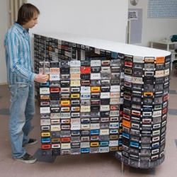 young dutch designer Patrick Schuur used a total of 918 tapes to build a cassette tape closet. Each cassette tape is individually screwed onto a wooden frame.