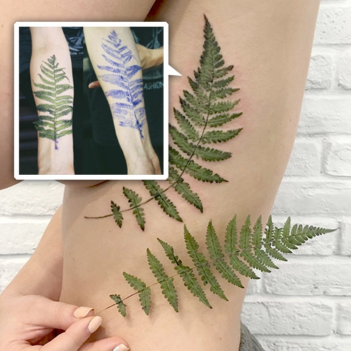 Rita, tattoo artist from Kiev, Ukraine first inks a plant to stamp it on to the body before free handing plant/flower inspired tattoos.