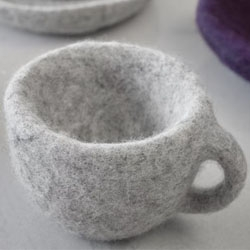 The Piloh project was born to prevent old objects from reaching their cruel destiny. Chipped marble cups, rusty spoons, broken object are trasformed and take on a new life. Wool, like a parasite, slowly appropriates the surface. By Paola Santilli.