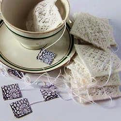 The hybrid design of typical teabag, created from handmade lace by designer Anna Zofia Borowska, to contrast the idea of a disposable item with elaborated and sophisticated form.