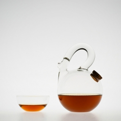 "Teapot ""Ball"" designed by Laurance Brabant - Simple and serene, these vessels for tea are the very essence of minimal design.  By highlighting the transparency of the container, Brabant creates a spectacle of the contents within."