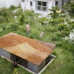 Modern tea house by Jun Igarashi Architects. Beautiful untreated concrete and rust colored roof that can double as a table.