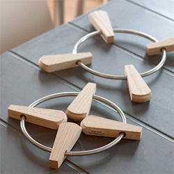 Solid teak and stainless steel trivet - Design: Designit, Denmark - gorgeously minimalistic and oh so functional.