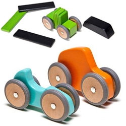 Tegu (the magnetic wooden blocks) now have WHEELS! Launching this month is the mobility series with magnetic wheels.