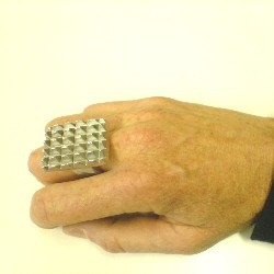 """Ken Goldman's """"tenderizer"""" ring .The ring is carved out of that never used """"shnitzel hammer""""! No web site available yet but you can reach ken at info@biblicalbeasties .com"""
