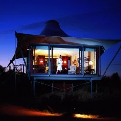 Voyages Longitude 131, at Uluru-Kata Tjuta National Park, Australia, is a resort featuring a cluster of 15 luxurious solar-powered tent cabins overlooking Uluru (Ayers Rock). What a setting!