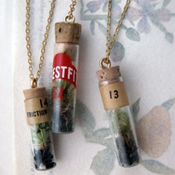 Erica Weiner Terrarium Jewelry - These vintage watchmakers' vials are carefully planted with a tiny living specimen of moss with charcoal at the base!