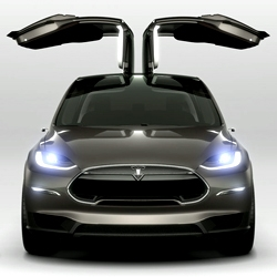 Tesla unveils the Model X at the 2013 Detroit Auto Show. The Model X has an optional dual electric motor all-wheel drive system that does 0-60mph in under 5 seconds.