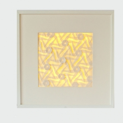 Math meets art with Comali. Give some light to your wall with this lighted frame, holding a tessellation made by only one folded sheet of handmade Japanese washi paper.