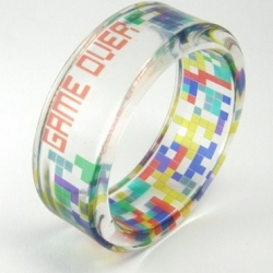 Beautiful Tetris bracelet by Sylwia Calus. There's one on sale in her Etsy shop for $70, but it's reserved for someone else. (Typically Etsy artists will create more of an item by commission.) I bet she could make a terrific Tron bracelet.