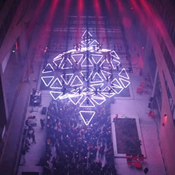 Grid, designed by Christopher Bauder for Tetro is a kinetic light installation composed of 50 triangles and 150 LED strips.